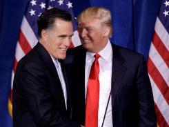 Donald Trump greets Mitt Romney during a Feb. 2 news conference in Las Vegas.