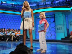 ESPN reporter Samantha Steele enlists the help of Lori Anne Madison, 6, of Woodbridge, Va., at the end of round 2 of the Scripps National Spelling Bee.