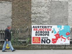 A man walks past a sign against the European Fiscal Treaty in Dublin on Wednesday ahead of Thursday's referendum.