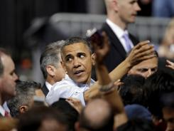 President Obama greets supporters after a campaign rally at Ohio State University in Columbus, Ohio, on May 5. Also attending: a Mitt Romney spokesman.