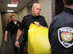 A police officer removes a package from the Conservative Party headquarters in Ottawa, Ontario, on Tuesday.