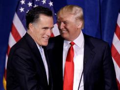 Mitt Romney greets Donald Trump at a news conference in Las Vegas on Feb. 2.
