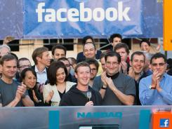 Facebook founder Mark Zuckerberg, center, rings the Nasdaq opening bell remotely from the company's headquarters in Menlo Park, Calif., on May 18.