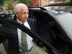 Jerry Sandusky gets into his attorney Joe Amendola's car near the Centre County Courthouse Annex in Bellefonte, Pa., on Tuesday.
