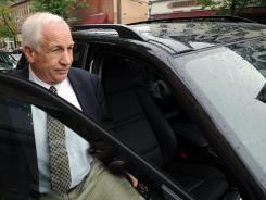 Jerry Sandusky gets into lawyer's car near the courthouse Tuesday in Bellefonte, Pa.