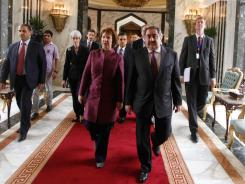 In Baghdad: Iraqi official Hoshyar Zebari walks with EU foreign policy chief Catherine Ashton.