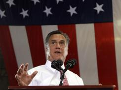 GOP nominee: Mitt Romney visits the Somers Furniture warehouse Tuesday in Las Vegas.