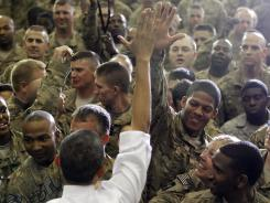 President Obama gets a high five as he visits troops May 2 at Bagram Air Field in Afghanistan.