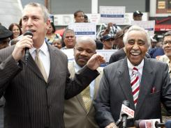 Rep. Charlie Rangel, D-N.Y., right, listens as Adam Clayton Powell IV endorses him at a New York event on May 23. Powell ran against Rangel in 2010.