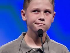 "Nathan Dugan of Canton, Ohio, spells ""cantankerous"" during the National Spelling Bee on Wednesday near Washington, D.C."
