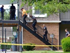 Police investigate a shooting Wednesday at the Villa Paree apartments in Indianapolis.