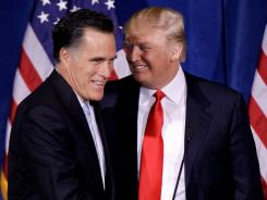 Donald Trump greets Mitt Romney during a news conference in Las Vegas in February.