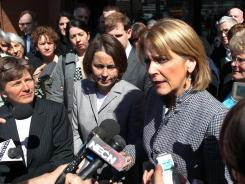 Massachusetts Attorney General Martha Coakley, right, addresses the media about the Defense of Marriage Act, on April 4 in Boston. At left is Gay & Lesbian Advocates & Defenders attorney Mary Bonauto.