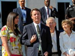 """There is no one else responsible for my sins"": John Edwards struck a tone of contrition as he addressed the news media alongside his daughter Cate, left, and parents, Wallace and Bobbie Edwards."