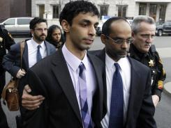 Dharun Ravi, center, and his father, Ravi Pazhani, after court in New Brunswick, N.J., in a March photo. Pazhani accompanied his son to the sheriff's office Thursday.