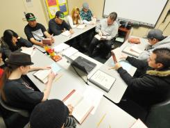 English class: A teacher goes over a lesson at the Options for Youth public charter school in Victorville, Calif., on March 21. Mitt Romney has downplayed the importance of class sizes in education.