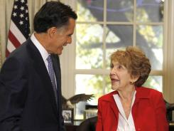 Mitt Romney meets with former first lady Nancy Reagan before a Republican presidential candidate debate at the Reagan Library Wednesday, Sept. 7, 2011, in Simi Valley, Calif.