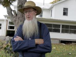 Amish leader Sam Mullet standing in front of his home in Bergholz, Ohio, in 2011. A judge has rejected a challenge of the federal hate crimes law by Amish defendants charged in beard-cutting attacks on fellow Amish in Ohio.