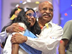 "Snigdha Nandipati, 14, celebrates winning the 2012 Scripps National Spelling Bee with her grandfather, Mallikarjanrao Chalavadi. Her winning word was ""guetapens."""