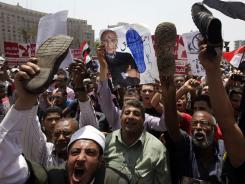 Egyptian protesters shout slogans against presidential candidate Ahmed Shafiq, who was forced to step down as prime minister after Mubarak's ouster last year.