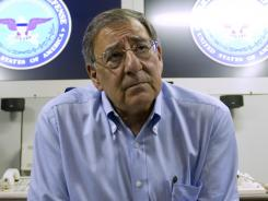 Secretary of Defense Leon Panetta listens to a question during a media briefing Friday on his plane.