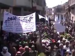 An image made from amateur video released by Shaam News Network and accessed Friday purports to show the funeral for a Syrian worker killed near Qusair as violence against civilians escalated.