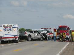 Emergency responders work at the scene of a fatal van and a pickup crash near Ansley, Neb. on Friday.