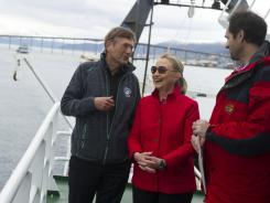 Hillary Rodham Clinton speaks with Jarle Aarbakke, left, rector of the University of Tromso, and Dr. Jan-Gunnar Winther, director of the Norwegian Polar Institute, onboard the Arctic Research Vessel Helmer Hanssen during a tour of a fjord.