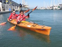 Kieron Leslie, left, and Ludwig Lin practice their paddling skills next to AT&T Park in San Francisco before heading to London to take part in the Thames Diamond Jubilee Pageant.