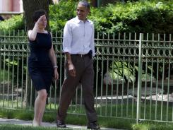President Obama walks through his Hyde Park neighborhood with senior adviser Valerie Jarrett to his friend, Marty Nesbitt's home, Saturday in Chicago.