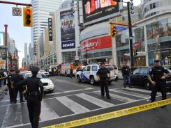 Police set up a perimeter outside the Eaton Centre shopping mall in Toronto on Saturday.