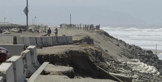 In San Francisco, a beach parking lot is crumbing into the sea just across the highway from the San Francisco Zoo.