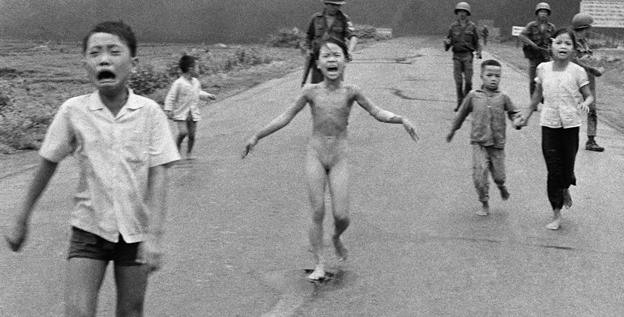 In this June 8, 1972 photo, crying children, including Kim Phuc, center, run from a burning Vietnamese village after a napalm attack.