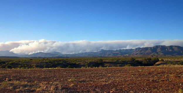 A massive plume of smoke rises in the Gila National Forest on Tuesday.