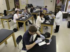 In this photo taken March 29, 2011, Sparkman High School students work in a science class in Sparkman, Ark., last year.
