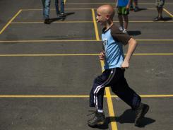 Matt Woodrum, 11, a fifth-grader at Colonial Hills Elementary School in Worthington, Ohio runs May 30 during recess.