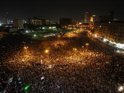 Protesters gather in Cairo's Tahrir Square on Saturday after former president Hosni Mubarak was given life in prison.