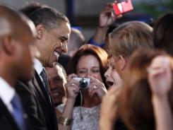 President Obama greets audience members after speaking at the National Hispanic Prayer Breakfast in Washington in 2011.