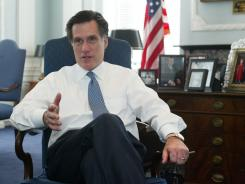 Then-Massachusetts Gov. Mitt Romney discusses the state budget during an interview in his office in Boston in 2003.