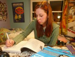 Krystyna Karmol, with some of her SAT study aids, took advantage of study workbooks, online assistance and study classes to help improve her score in 2004.