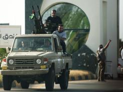 The militia of Libyan ex-rebels seized control of the airport, surrounding planes with tanks and grounding all flights.