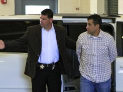 After his bond was revoked, George Zimmerman, right, returns to the John E. Polk Correctional Facility in Sanford, Fla., on Sunday.