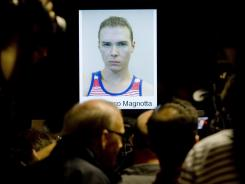 A photo of Luka Rocco Magnotta is shown during a news conference in Montreal on Tuesday. Magnotta told a judge he will not fight extradition from Germany.