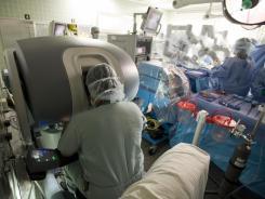Cardiac surgeon Sudhir Srivastava performs robotic cardiac surgery at the University of Chicago Medical Center.