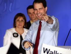 Wisconsin Gov. Scott Walker celebrates after Tuesday's election.