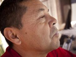 Retired Army Staff Sgt. Emanuel Herrera smokes medical marijuana at his Phoenix home.