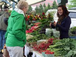 Seasonal produce and flowers are all on the offer at the farmers market in Bloomington, Ind.