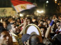 Egyptian protesters chant slogans during a demonstration in Tahrir Square to protest against the mixed verdict on former leader Hosni Mubarak late Monday.