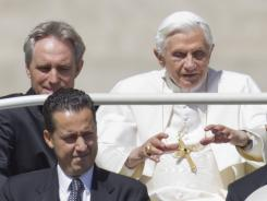 Paolo Gabiele, bottom left, arrives with Pope Benedict XVI at Saint Peter's Square at the Vatican on May 23.