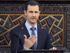 Syrian President Bashar Assad expresses horror on Sunday over the Houla massacre that left more than 100 people dead.